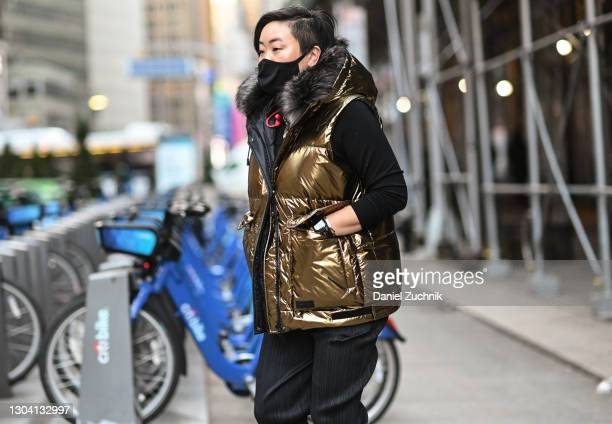 Aya Kanai is seen wearing a gold puff vest outside the Christian Siriano show during New York Fashion Week F/W21 on February 25, 2021 in New York...