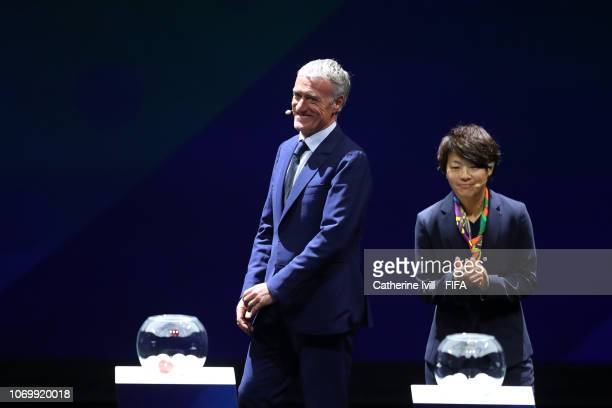 Aya Miyama and Didier Deschamps on stage during the FIFA Women's World Cup France 2019 Draw at La Seine Musicale on December 8 2018 in Paris France