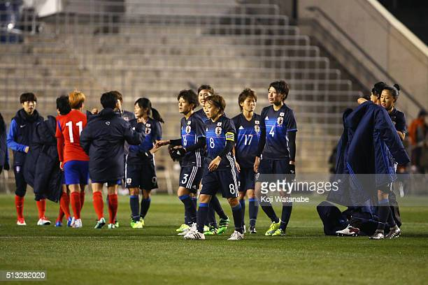 Aya Miyama and Japanese players show their dejection after their 11 draw in the AFC Women's Olympic Final Qualification Round match between Japan and...
