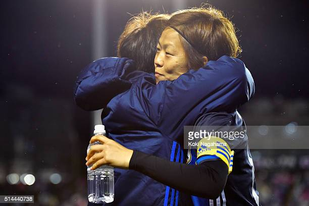 Aya Miyama and Mana Iwabuchi of Japan hug each other prior to the AFC Women's Olympic Final Qualification Round match between Japan and North Korea...