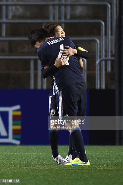 Aya Miyama and Saki Kumagai of Japan celebrate their 10 win in the AFC Women's Olympic Final Qualification Round match between Japan and North Korea...
