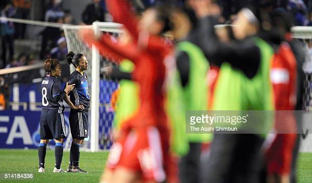 Aya Miyama consoles Yuki Ogimi of Japan after the AFC Women's Olympic Final Qualification Round match between Japan and China at Kincho Stadium on...