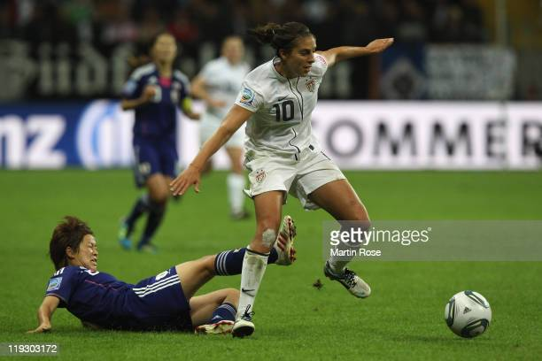 Aya Miyama of Japan and Carli Lloyd of USA battle for the ball during the FIFA Women's World Cup Final match between Japan and USA at the FIFA World...