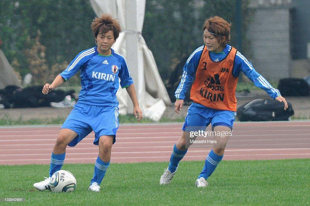Aya Miyama #8 of Japan (L) and Mizuho Sakaguchi #6 in action during the training session at Jinan Olympic Center Traning ground 1 on September 2, 2011 in Jinan, China.
