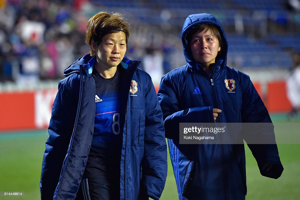 Aya Miyama (L) of Japan applauds supporters while Mana Iwabuchi (R) sheds tears after the AFC Women's Olympic Final Qualification Round match between Japan and North Korea at Kincho Stadium on March 9, 2016 in Osaka, Japan.