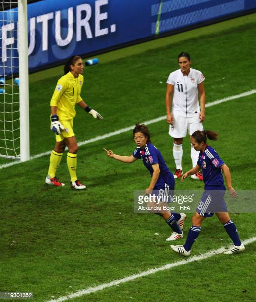 Aya Miyama of Japan celebrates her first goal against goalkeeper Hope Solo of USA during the FIFA Women's World Cup Final match between Japan and USA...