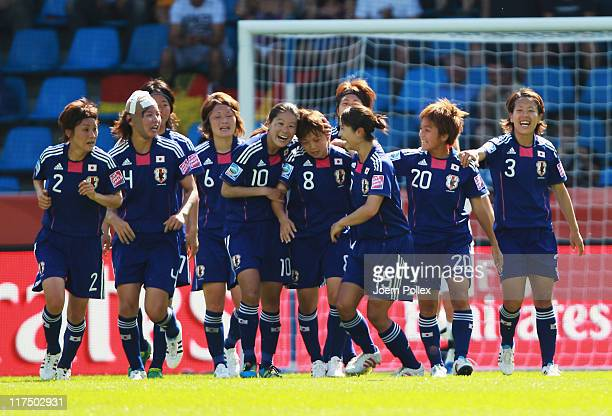 Aya Miyama of Japan celebrates with her team mates after scoring her team's second goal during the FIFA Women's World Cup 2011 Group B match between...