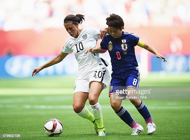 Aya Miyama of Japan challenges Carli Lloyd of USA during the FIFA Women's World Cup Final between USA and Japan at BC Place Stadium on July 5 2015 in...