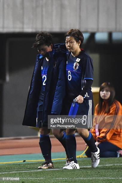 Aya Miyama of Japan consoles her team mate Kumi Yokoyama during the AFC Women's Olympic Final Qualification Round match between Japan and China at...