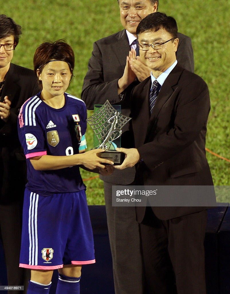 Aya Miyama of Japan is presented with the Asian Cup after they defeated Australia 1-0 in the AFC Women's Asian Cup Final match between Japan and Australia at Thong Nhat Stadium on May 25, 2014 in Ho Chi Minh City, Vietnam.