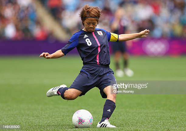 Aya Miyama of Japan passes the ball during the Women's Football first round Group F Match of the London 2012 Olympic Games between Japan and Sweden...