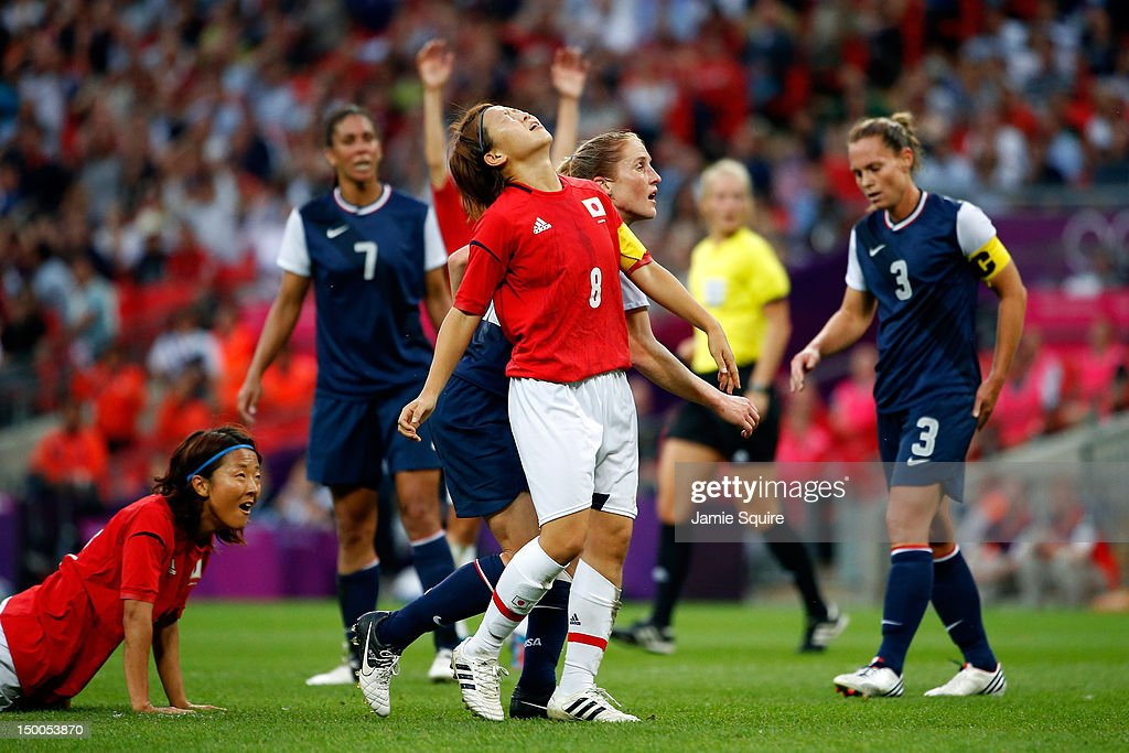 Aya Miyama #8 of Japan reacts after hitting the cross bar on a shot in the first half against the United States during the Women's Football gold medal match on Day 13 of the London 2012 Olympic Games at Wembley Stadium on August 9, 2012 in London, England.
