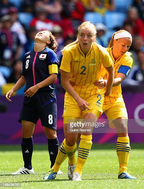 Aya Miyama of Japan reacts after missing a shot on goal during the Women's Football first round Group F Match of the London 2012 Olympic Games...