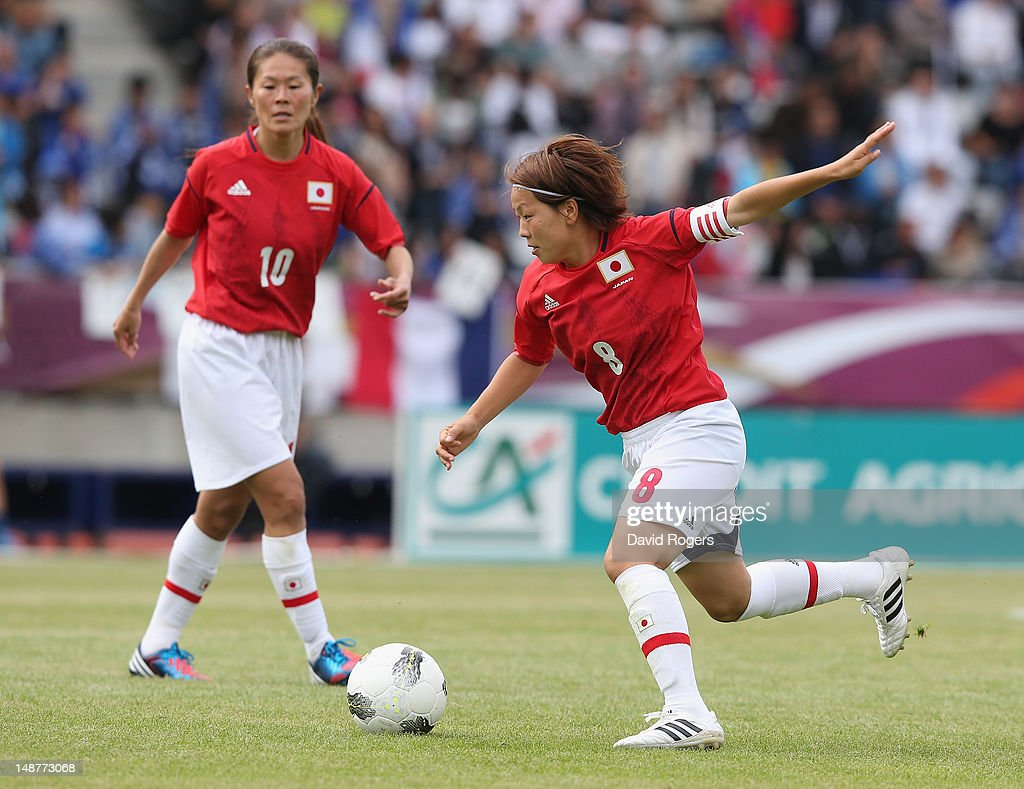 Aya Miyama of Japan runs with the ball during the friendly international match between Japan Women and France Women at Stade Charlety on July 19, 2012 in Paris, France.