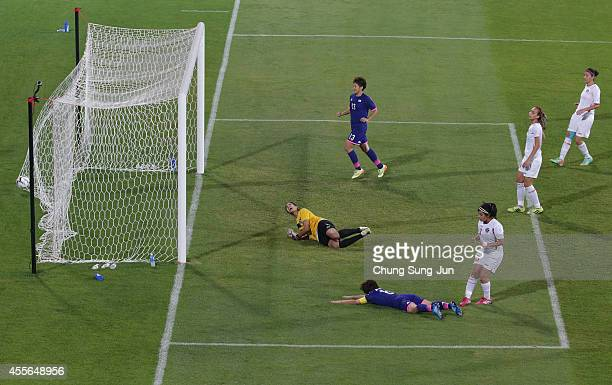 Aya Miyama of Japan scores a goal during the Women's Football Group B match between Japan and Jordan at Namdong Asiad Rugby Field during day -1 of...