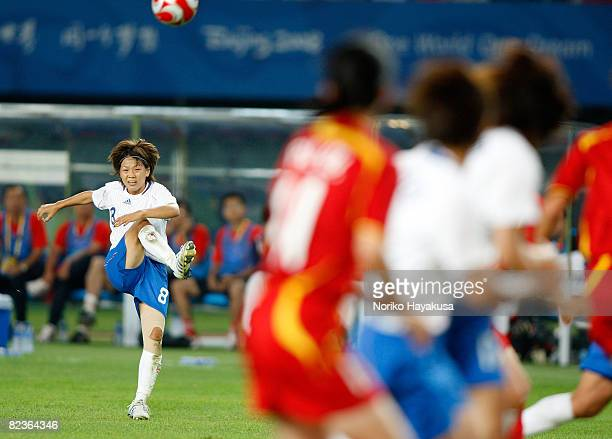 Aya Miyama of Japan takes a freekick during the Women's Quarter Final match between China and Japan at Qinhuangdao Olympic Sports Center Stadium on...