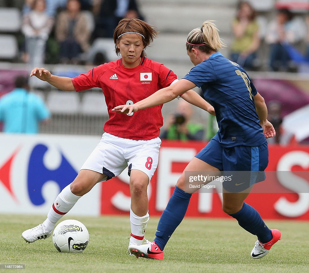 Aya Miyama of Japan takes on Camille Abily during the friendly international match between Japan Women and France Women at Stade Charlety on July 19, 2012 in Paris, France.