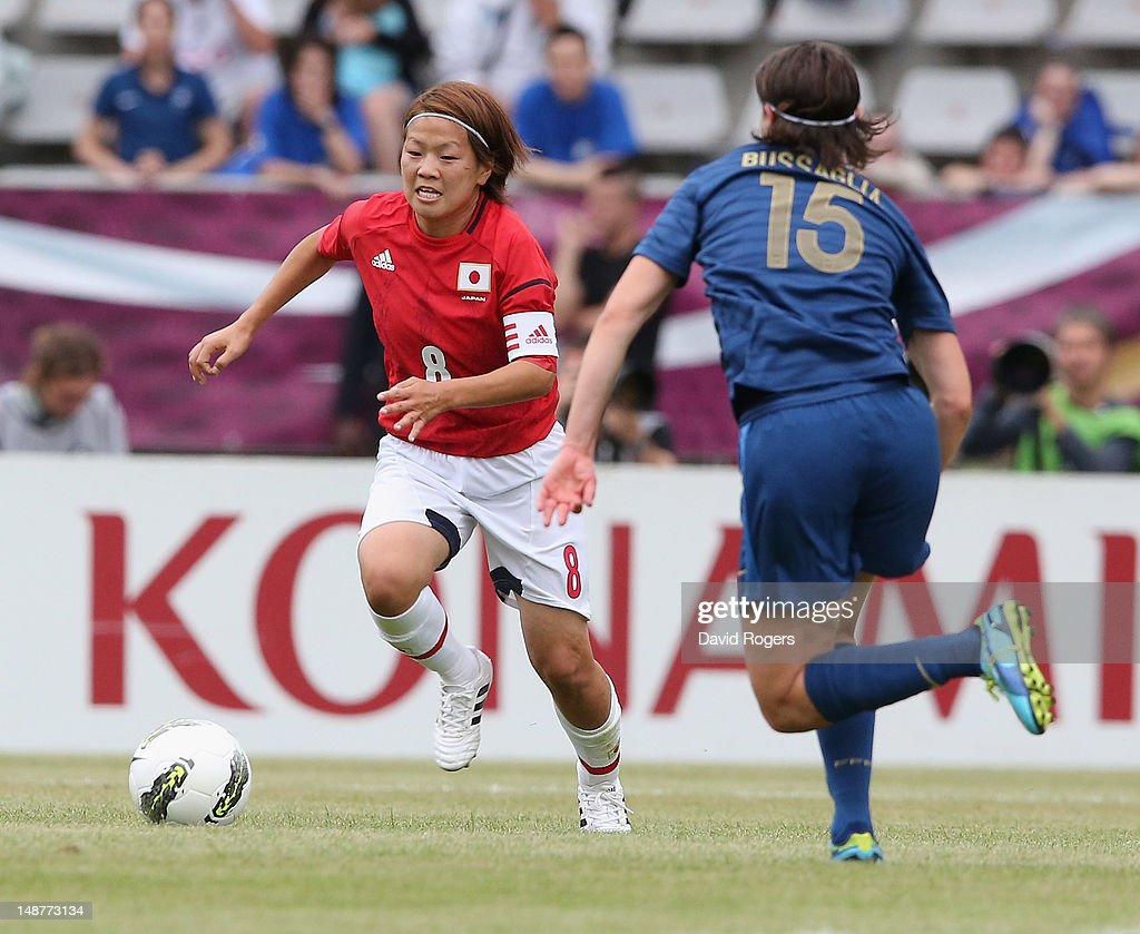 Aya Miyama of Japan takes on Elisa Bussaglia during the friendly international match between Japan Women and France Women at Stade Charlety on July 19, 2012 in Paris, France.