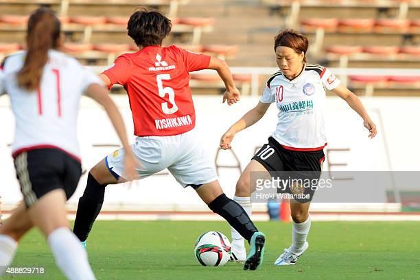 Aya Miyama of Yunogo Belle and Natsuki Kishikawa of Urawa Reds Ladies compete for the ball during the Nadeshiko League match between Urawa Red...