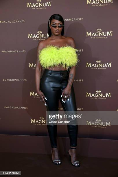 """Aya Nakamura attends the photocall for """"MAGNUM x Rita Ora"""" during the 72nd annual Cannes Film Festival on May 16, 2019 in Cannes, France."""