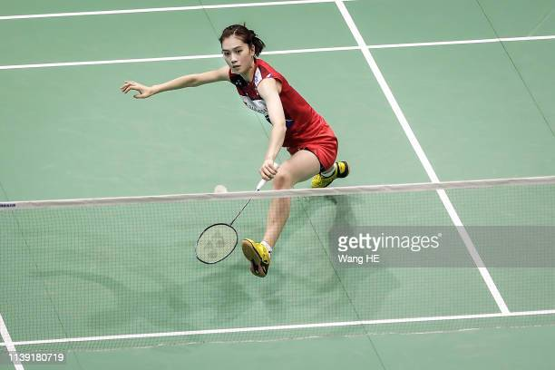 Aya Ohori of Japan hits a return during the women's singles match against Chung Ngan Yi of HongKong at the 2019 Badminton Asia Championships on Apirl...