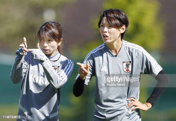 Aya Sameshima and Saki Kumagai are pictured during a training session of the Japan women's football team in Le Touquet France on May 28 ahead of a...