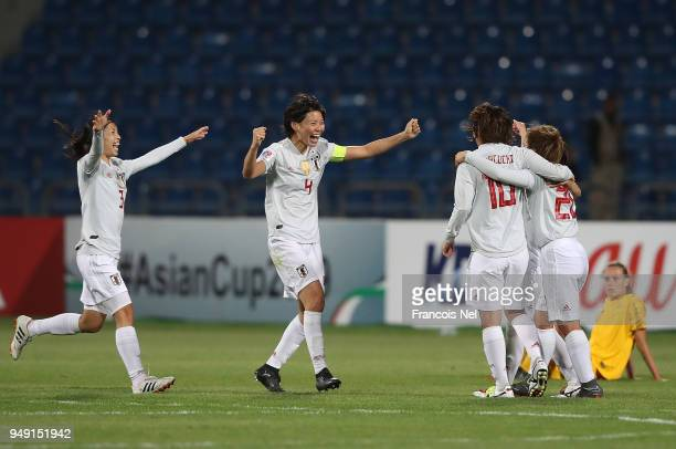 Aya Sameshima and Saki Kumagai of Japan celebrate with the team winning the AFC Women's Asian Cup final between Japan and Australia at the Amman...