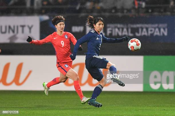 Aya Sameshima of Japan and Kang Yumi of South Korea compete for the ball during the EAFF E1 Women's Football Championship between Japan and South...