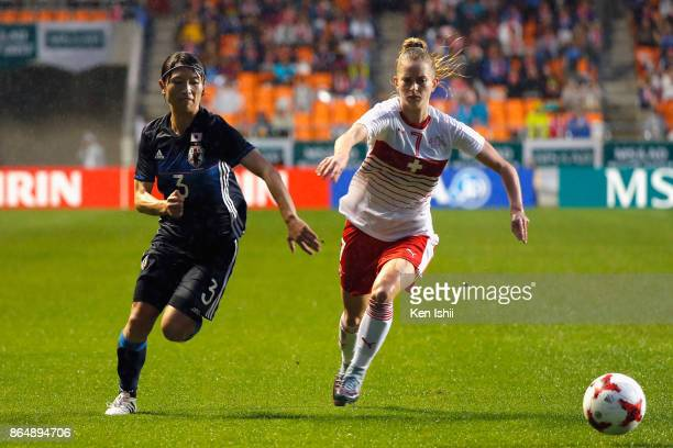 Aya Sameshima of Japan and Marilena Widmer of Switzerland compete for the ball during the international friendly match between Japan and Switzerland...