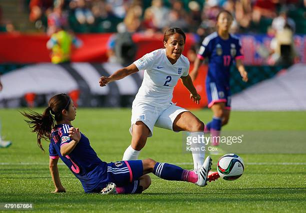 Aya Sameshima of Japan challeneges Alex Scott of England during the FIFA Women's World Cup Semi Final match between Japan and England at the...
