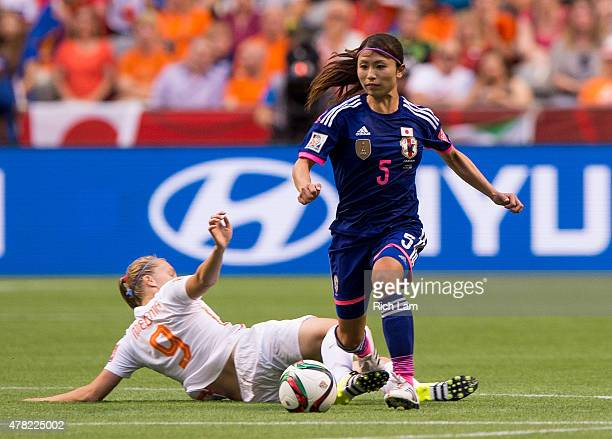 Aya Sameshima of Japan gets away from the sliding tackle of Vivianne Miedema of the Netherlands during the FIFA Women's World Cup Canada 2015 Round...