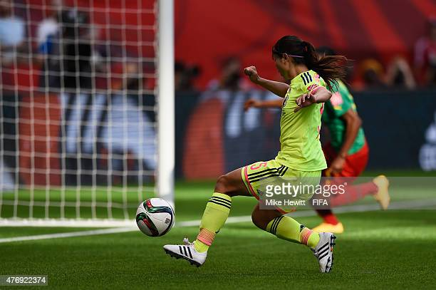 Aya Sameshima of Japan opens the scoring during the FIFA Women's World Cup 2015 Group C match between Japan and Cameroon at BC Place Stadium on June...