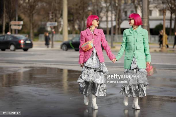 Aya Suzuki Ami Suzuki of Amiaya wearing Chanel pink and green jacket frill maxi skirt and orange Chanel bag outside the Chanel show during Paris...