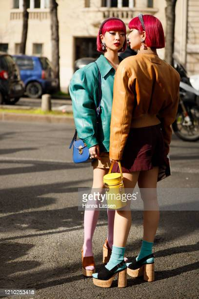 Aya Suzuki, Ami Suzuki of Amiaya wearing Miu Miu leather jacket in blue, yellow drum clutch outside Miu Miu show during Paris Fashion Week Womenswear...