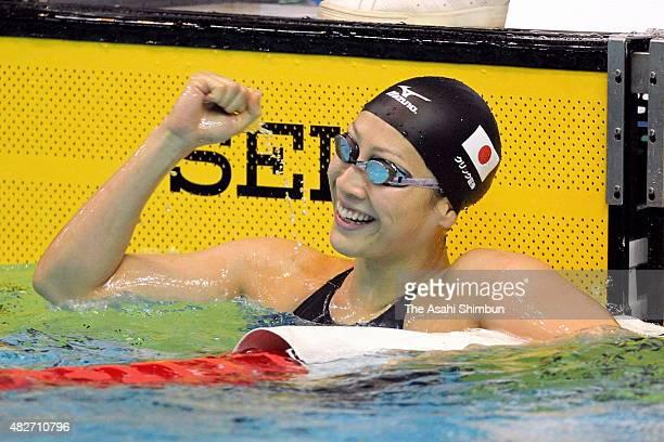 Aya Terakawa of Japan celebrates winning the Women's 100m Backstroke final during day two of the FINA World Cup Tokyo at Tokyo Tatsumi international...