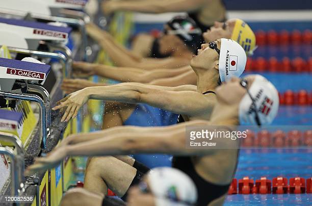 Aya Terakawa of Japan competes in heat one of the Women's 4 x 100m Medley Relay heats during Day Fifteen of the 14th FINA World Championships at the...