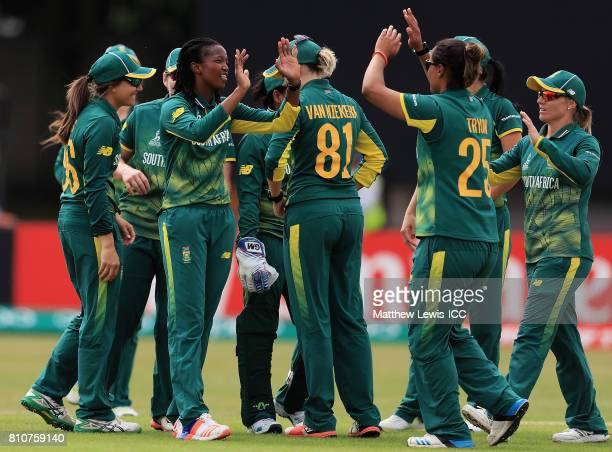 Ayabonga Khaka of South Africa is congratulated on bowling Punam Raut of India during the ICC Women's World Cup 2017 match between South Africa and...
