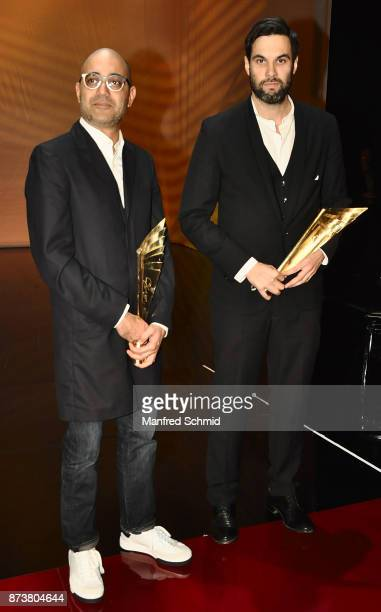 Ayad Akhtar and Max Simonischek pose during the Nestroy Theatre Award at Ronacher Theater on November 13 2017 in Vienna Austria