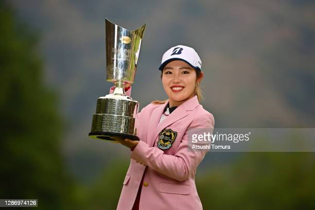 Ayaka Furue of Japan poses with the trophy after winning the tournament following the final round of the Daio Paper Elleair Ladies Open at the...