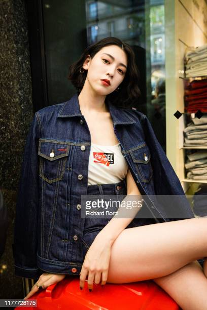 Ayaka Miyoshi attends the Diesel X Coca Cola Womenswear Spring/Summer 2020 show at Galeries Lafayette as part of Paris Fashion Week on September 28...