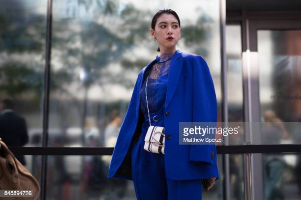 Ayaka Miyoshi is seen attending 31 Phillip Lim during New York Fashion Week wearing a blue dress and blazer on September 11 2017 in New York City