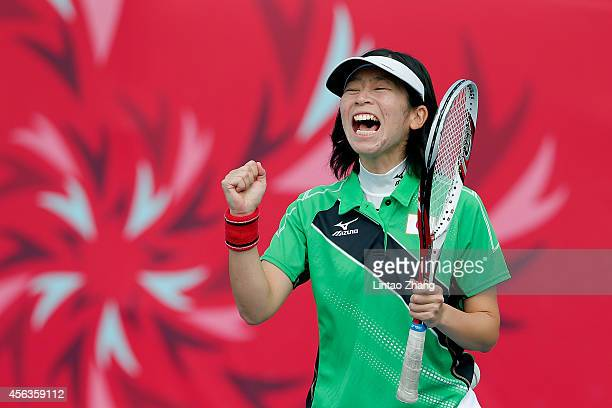 Ayaka Oba of Japan celebrates a point during the Women's Singles Preliminary Group B against Pitri Dwi Rahayu of Indonesia on day eleven of the 2014...