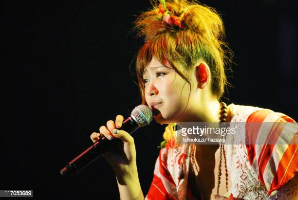 Ayaka performs on stage at the Tokyo leg of the Live Earth series of concerts, at Makuhari Messe, Chiba on July 7, 2007 in Tokyo, Japan.