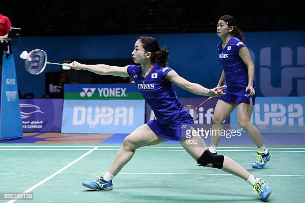 Ayaka Takahashi and Misaki Matsutomo of Japan compete during women's doubles final match against Chen Qingchen and Jia Yifan of China on Day 5 of the...