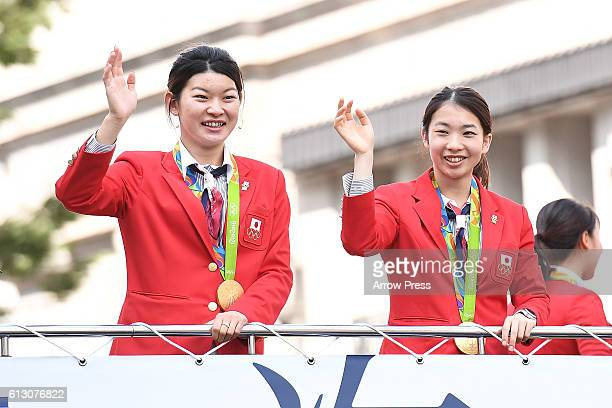Ayaka Takahashi and Misaki Matsutomo wave on the top of a double decker bus during the Rio Olympic Paralympic 2016 Japanese medalist parade in the...