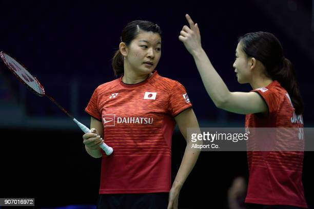 Ayaka Takashi of Japan speaks to her teammate Misaki Matsutomo plays during the Women's Double Quarter Finals of the Perodua Malaysia Masters 2018 at...