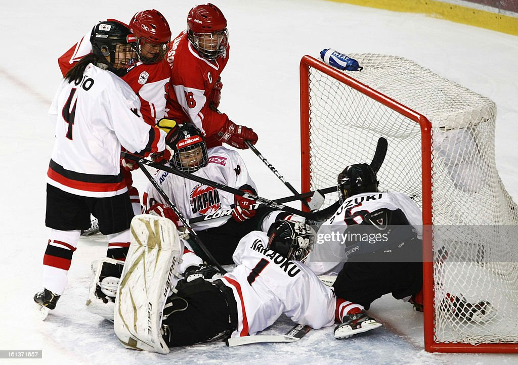 Ayaka Toko (L) , Haruna Yoneyama (C), Azusa Nakaoku (2nd from R) Sena Suzuki (R) of Japan fight for puck with Line Ernst (2nd from L), Maria Olausson (3th from L) of Denmark during the Women's ice hockey Olympic qualification group C match Denmark vs Japan in Poprad on February 10,2013.