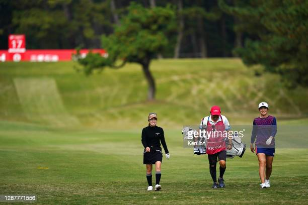 Ayaka Watanabe and Yuna Nishimura of Japan shake a laugh on the 17th hole during the first round of the JLPGA Tour Championship Ricoh Cup at the...