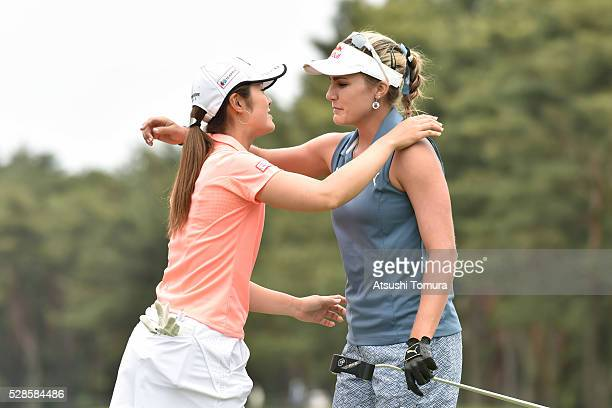 Ayaka Watanabe of Japan and Lexi Thompson of the USA hug during the second round of the World Ladies Championship Salonpas Cup at the Ibaraki Golf...