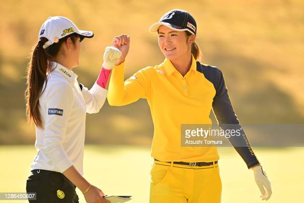 Ayaka Watanabe of Japan and Mone Inami of Japan elbow bump after holing out on the 9th green during the first round of the Daio Paper Elleair Ladies...